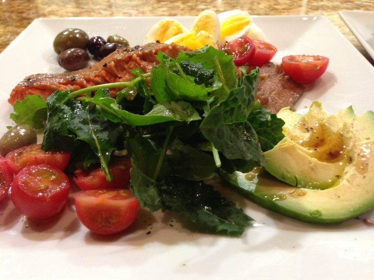 Nicoise salad with kale, avocado, cherry tomatoes, sardines, eggs and olives.  Doesn't get much healthier than this!