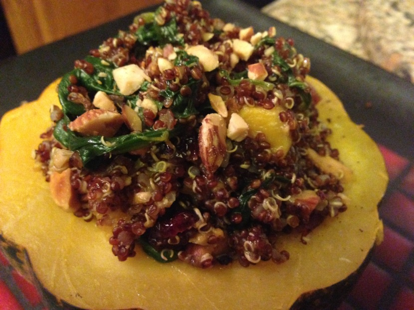 Acorn squash stuffed with Curry Mustard Quinoa, Butternut Squash, Spinach, Cranberries and Toasted Almonds