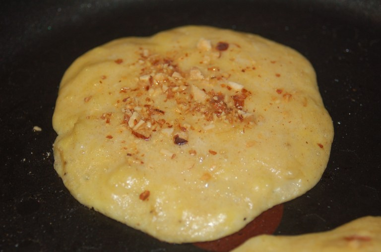 Sprinkle toasted and finely chopped almonds to add a nice crunch to the pancake.