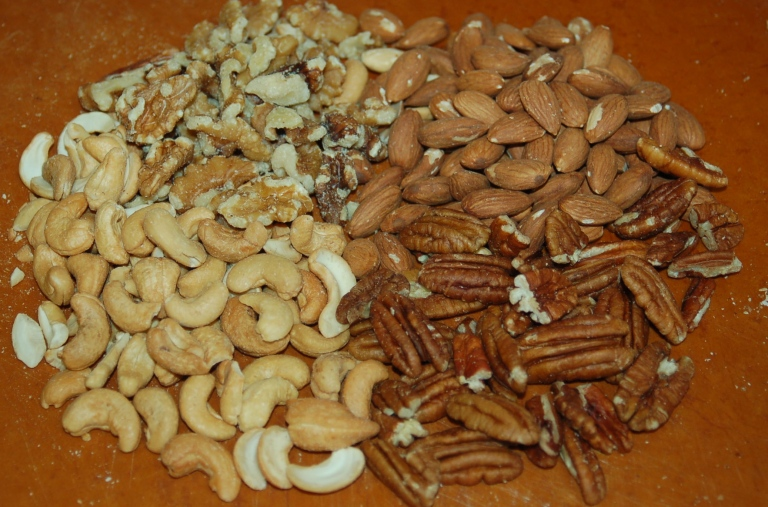 I like a variety of nuts, including walnuts, almonds, pecans and cashews, in my granola.  Choose the combination of you enjoy most.